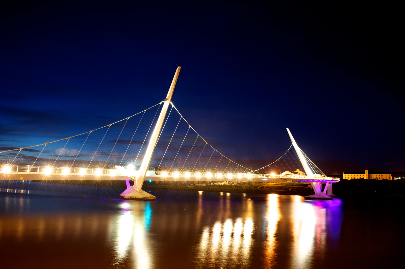 Derry's new peace bridge lights up the night sky as Derry prepares for it's opening next weekend. (1806SL01) Photo: Stephen Latimer