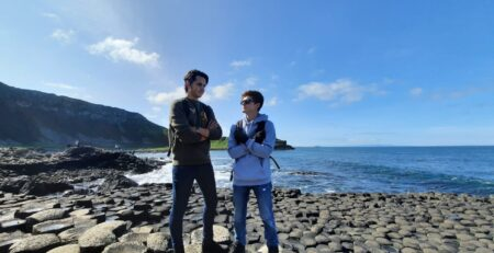 ITalian tudents at Giants Causeway in northern ireand on a sunny day