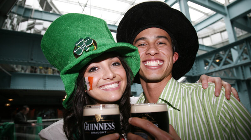 people celebrating st patricks day with guinness